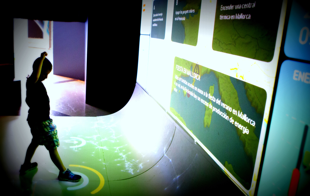 Child playing with interactive displays of the exhibition