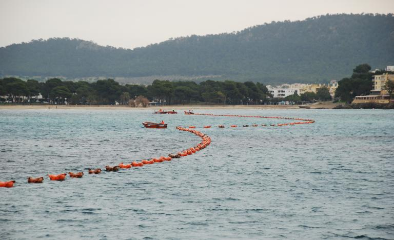 Laying of the submarine cable with the aid of floats in Santa Ponsa Bay in Mallorca