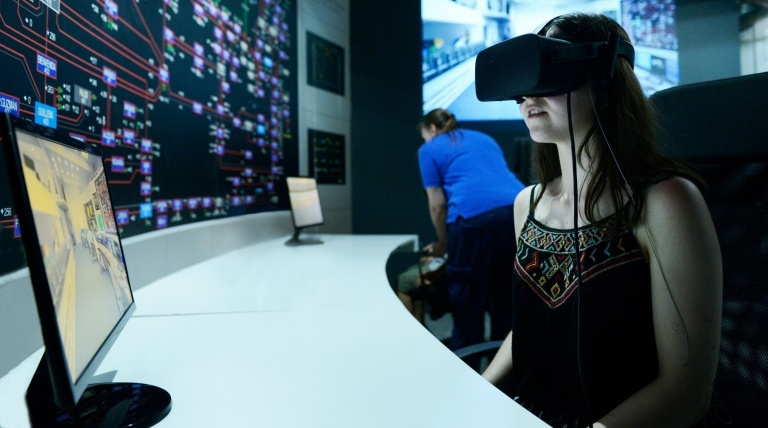 A visitor taking the virtual tour of the Cecoel (Electrical Control Centre).