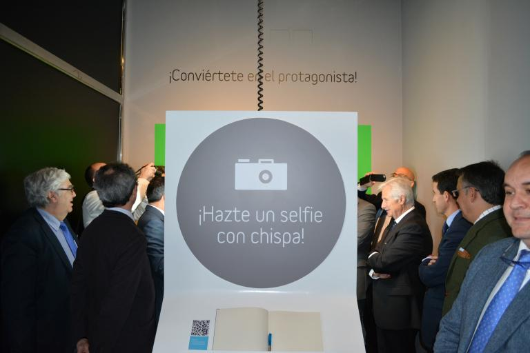 Officials taking selfies in the exhibit's new photo booth.